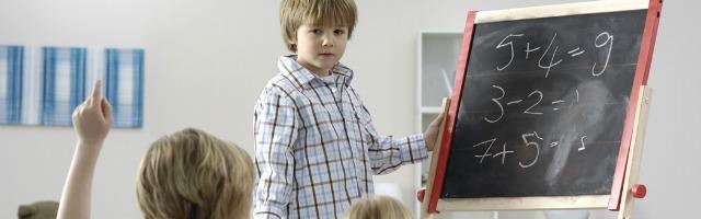 kid-teaching-kid-resized